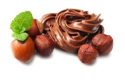 Chocolate cream with hazelnut isolated on white background Stock Images