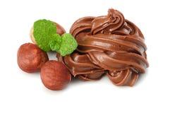 Chocolate cream with hazelnut isolated on white background Royalty Free Stock Images