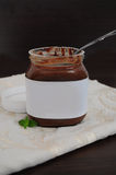 Chocolate cream in jar. With spoon Stock Images
