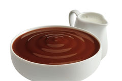 Chocolate cream with milk. Cup of chocolate cream with milk royalty free stock photo