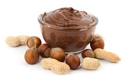 Chocolate cream and nuts. Delicious chocolate cream in a bowl and nuts isolated on white stock images