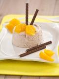 Chocolate cream. With orange pieces of tenderloin stock images