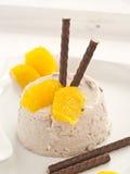 Chocolate cream. With orange pieces of tenderloin stock photo