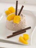 Chocolate cream. With orange pieces of tenderloin royalty free stock photos