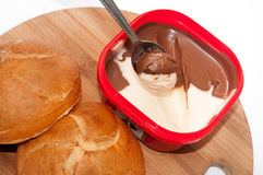 Chocolate cream on the spoon in the shallow focus Royalty Free Stock Photos