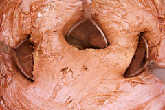 Chocolate cream with spoons Stock Photos