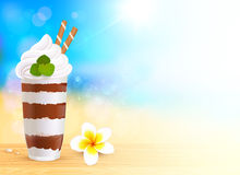 Chocolate creamy dessert on blurred summer beach Stock Images
