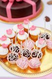 Chocolate and creamy pop cakes and cupcakes royalty free stock image