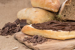 Chocolate Creme on a bun (rustic background) Royalty Free Stock Images