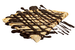 Chocolate crepe. A chocolate crepe isolated on a white background royalty free stock image