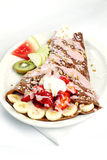 Chocolate crepe with banana strawberry and yogurt Stock Photos