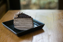 Chocolate Crepe cake and fork Royalty Free Stock Images