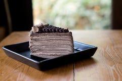 Chocolate Crepe cake and fork Stock Image