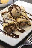 Chocolate crepe with ice cream. On a white plate Stock Images