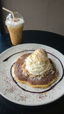 Chocolate crepe served with ice cream and whipping cream at coffee cafe Stock Photography