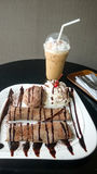 Chocolate crepe served with ice cream and whipping cream Stock Photography