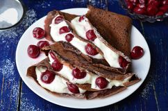 Chocolate Crepes with Cherry royalty free stock photos