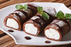Chocolate crepes with cream cheese close-up horizontal Stock Image