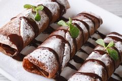Chocolate crepes with sauce and mint close up horizontal Stock Images
