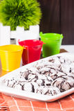 Chocolate crinkles. Homemade cracked powdered sugar chocolate crinkled Royalty Free Stock Image