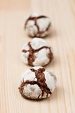 Chocolate crinkles in a row Stock Photo