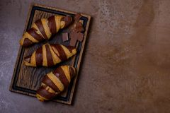 Chocolate croissant and chocolatier on table royalty free stock image