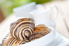 Chocolate croissant in an outdoor setting. Stock Photo