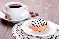 Chocolate croissant on the plate and coffee Stock Images