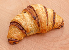 Chocolate croissant on the wooden background Stock Image