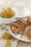 Chocolate croissants, grapes and coffee Royalty Free Stock Images