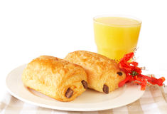 Chocolate croissants and orange juice. On white plate Stock Photography