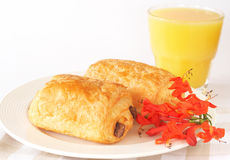 Chocolate croissants and orange juice. On white plate Royalty Free Stock Image