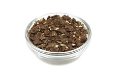 Chocolate crumb in a glass bowl Stock Image