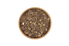 Chocolate crumb in a wooden bowl Royalty Free Stock Images
