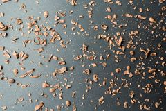 Chocolate crumbs on a black background with a gradient of light royalty free stock photography