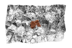 Chocolate crumbs on tin foil. Last small chocolate crumbs on silver tin foil Royalty Free Stock Images
