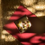 Chocolate cube. The chocolates cube with milk, raisins and nuts stuffed. Chocolate is yummy Royalty Free Stock Photography
