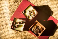 Chocolate cube. The chocolates cube with milk, raisins and nuts stuffed. Chocolate is yummy Stock Image