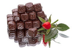 Chocolate cubes and rose Stock Images