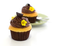 Chocolate cup cake. And defocus of dish Royalty Free Stock Photos