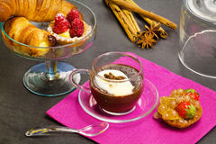 Chocolate cup with ccroissant and fancy cakes Stock Image