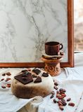 Chocolate and a cup of coffee on marble background. Good morning Stock Photos