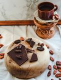 Chocolate and a cup of coffee on marble background. Good morning Royalty Free Stock Image
