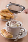 Chocolate cup with whipped cream and ladyfingers. On wooden table Royalty Free Stock Photos