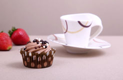 Chocolate cupcake. With cup of coffee Royalty Free Stock Image