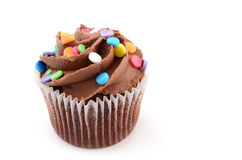Chocolate cupcake. Mini chocolate cupcake with colorful sprinkles isolated on white background Royalty Free Stock Image