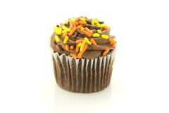 Chocolate cupcake. Detail of a chocolate cupcake with icing or frosting and candy sprinkles Royalty Free Stock Photo