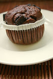 Chocolate cupcake. On a white plate Stock Photography