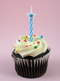 Chocolate cupcake with birthday candle Stock Images