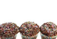 Chocolate cupcake bottom border on white. Royalty Free Stock Photo